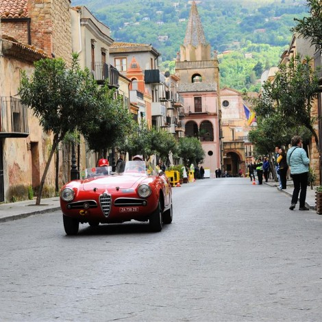 """Targa Florio 2017, one of the Scuderia del Portello's cars during the race, in the peculiar """"frame"""" of one of the historical places of Sicily"""